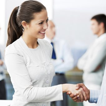 Multiracial business people shaking hands to confirm a deal.  [url=http://www.istockphoto.com/search/lightbox/9786622][img]http://dl.dropbox.com/u/40117171/business.jpg[/img][/url]